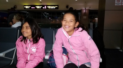 pink and thrilled to be entertained by their Papa while waiting to board